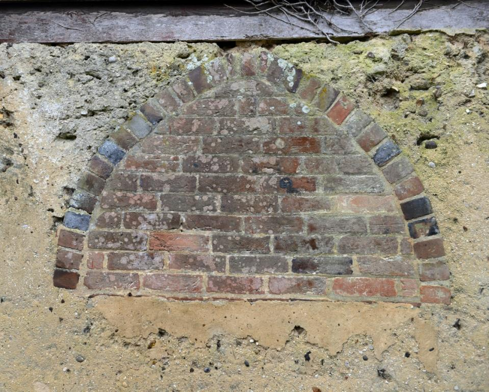 Bricked up arched window in North elevation